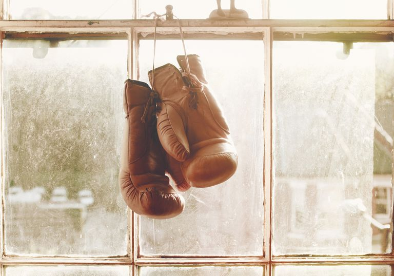boxing gloves hanging in front of window