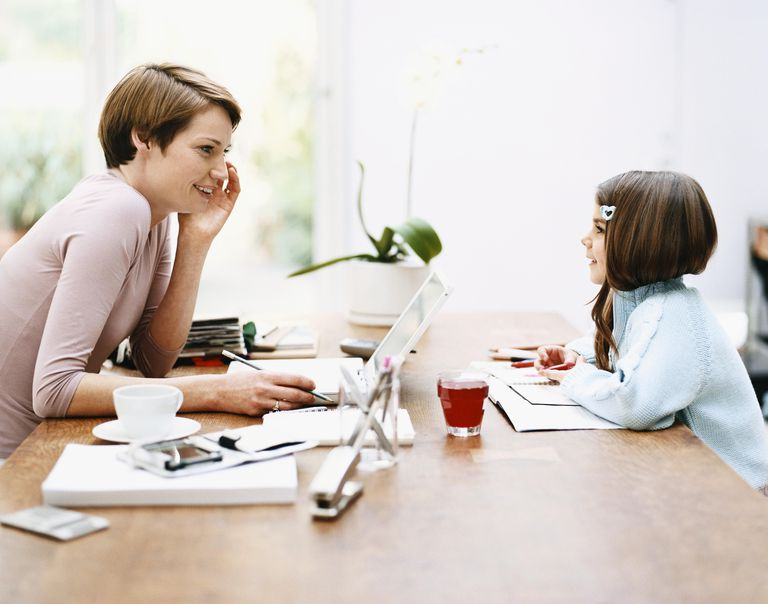 Mother Talking to Her Daughter Across a Table at Home