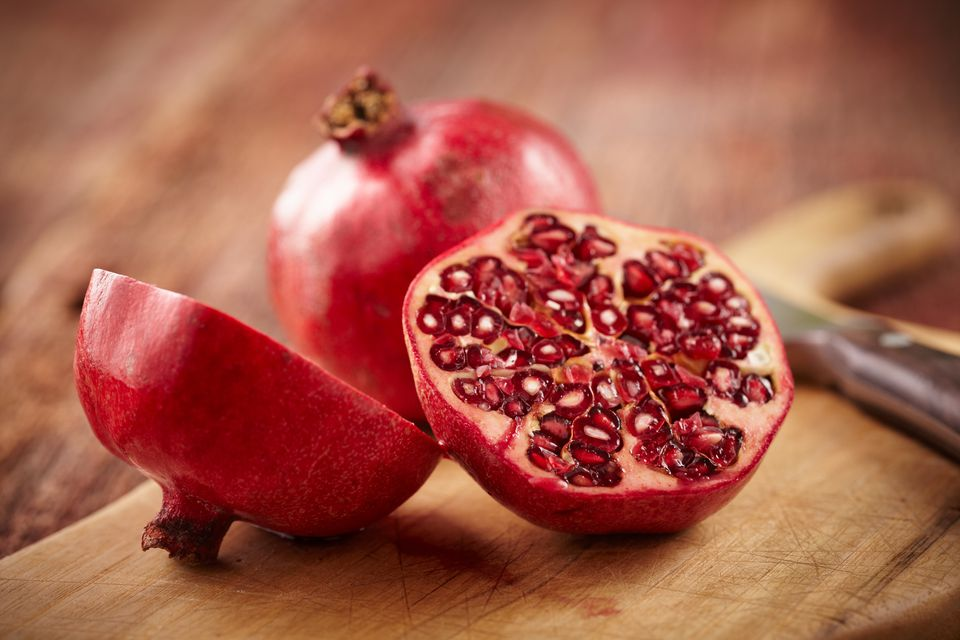 Pomegranate fruit on cut board