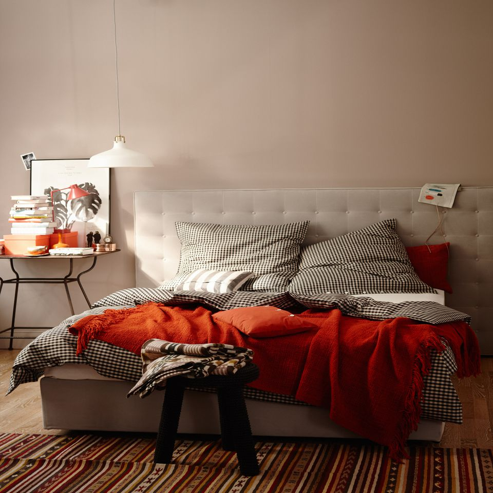 Neutral bedroom with orange accents.