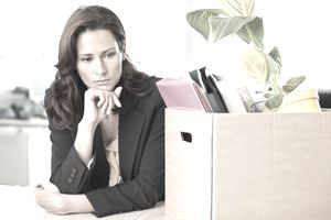 fired businesswoman with a box of belongings