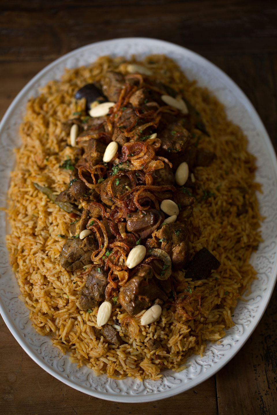 lamb and almonds on bed of rice