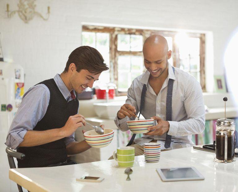 Businessmen having breakfast together
