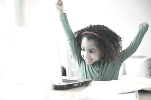 Picture of a girl winning at her computer.