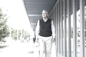 Senior adult businessman walking with shopping bags