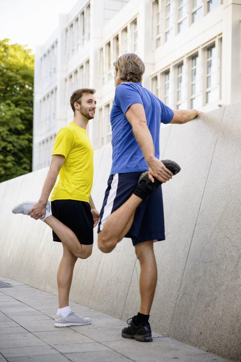 two men stretching quadriceps