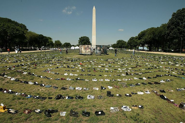 Hundreds of pairs of shoes are set out in laybyrinths along the National Mall to symbolize the estimated 100,000 Iraqi civilians who have died since in the war during the 'Eyes Wide Open: The Human Cost of War' exhibition May 12, 2006 in Washington, DC. The exhibition also includes 2433 pairs of boots to symbolize the U.S. military personnel who have died in Iraq since the start of the war in 2003. The Washington Monument is in the background. The exhibition is organized by the American Friends Service Committee and will be on display until May 14, 2006