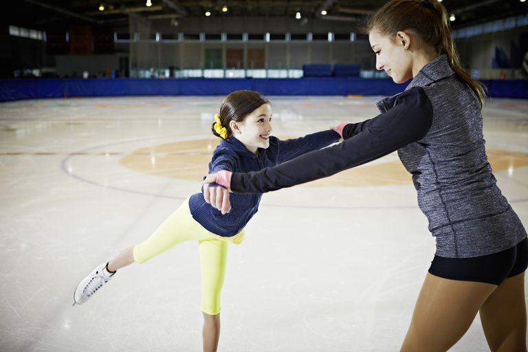 Child ice skater practicing