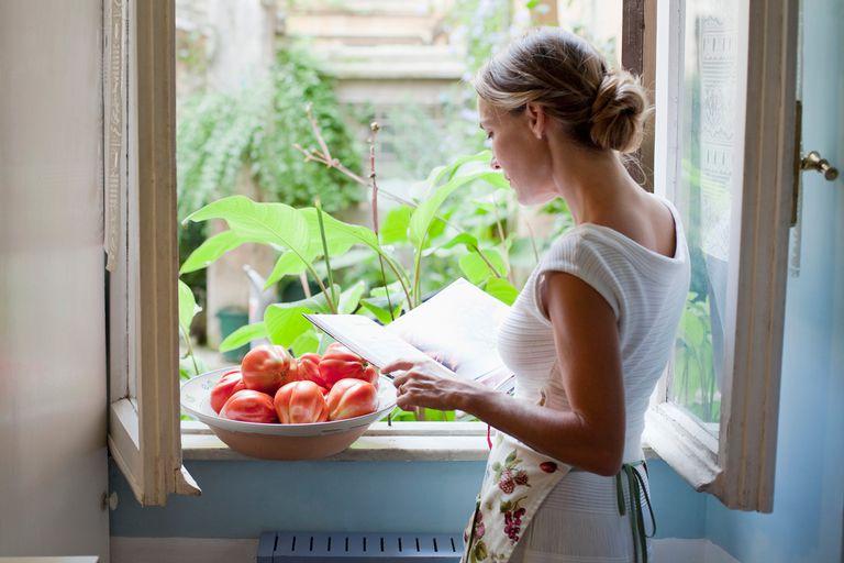 Woman reading cookbook