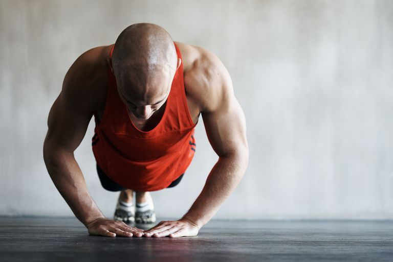 Man doing triangle push up