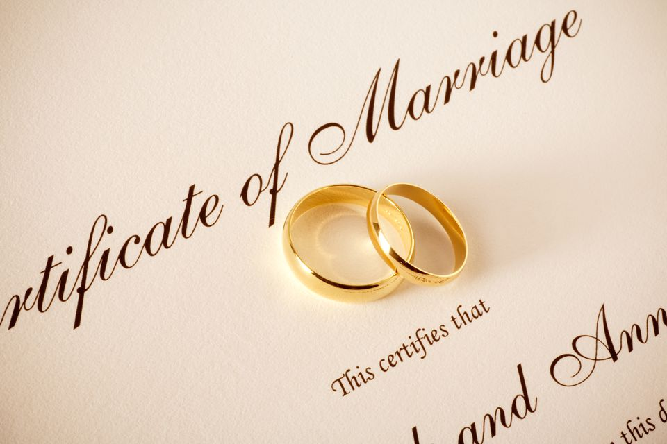 Marriage Certificate and Wedding Rings
