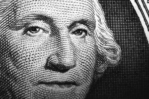 close up of George Washington's portrait on the dollar bill