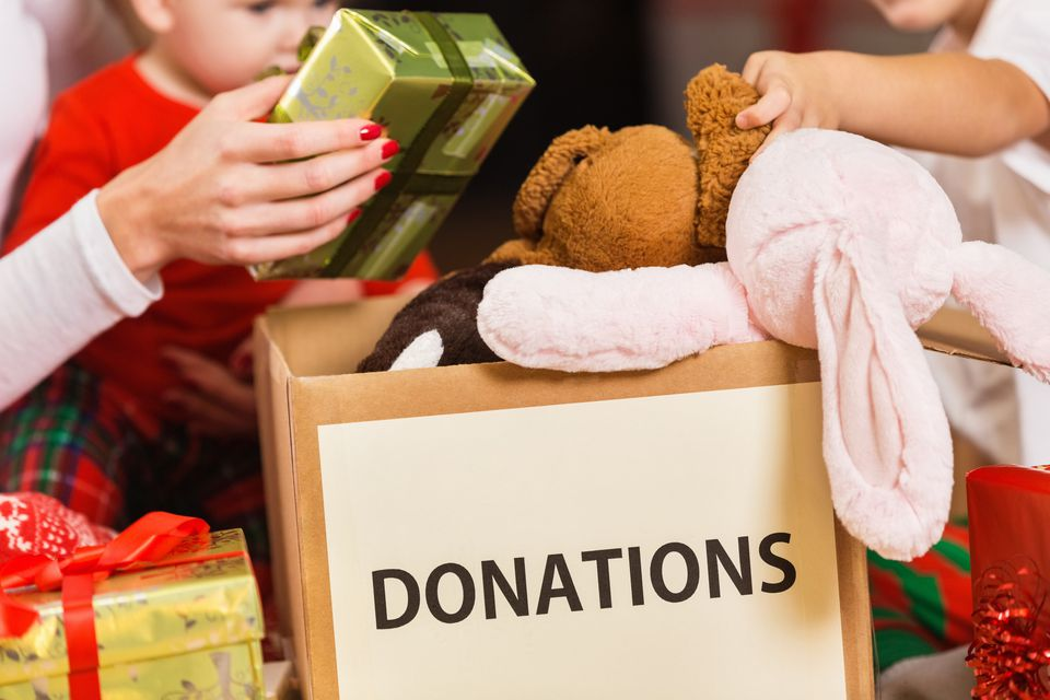 Gifts being put into a donation box.