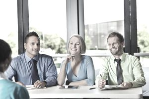 Diverse business team conducting interview or review with prospective employee