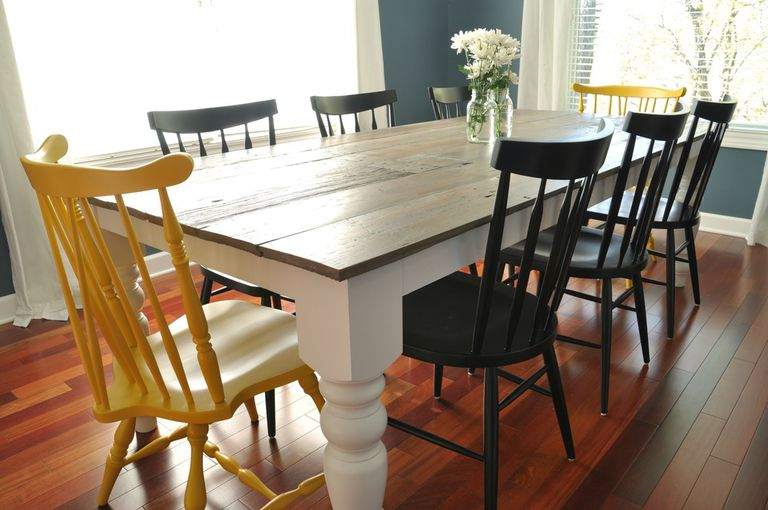 A Farmhouse Table With Mismatched Chairs