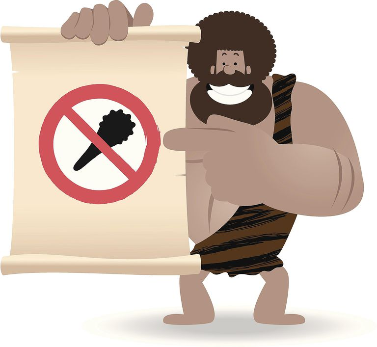 caveman holding a 'no clubbing' sign