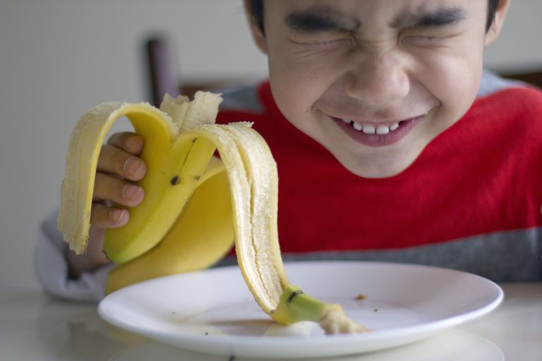 Boy eatting banana