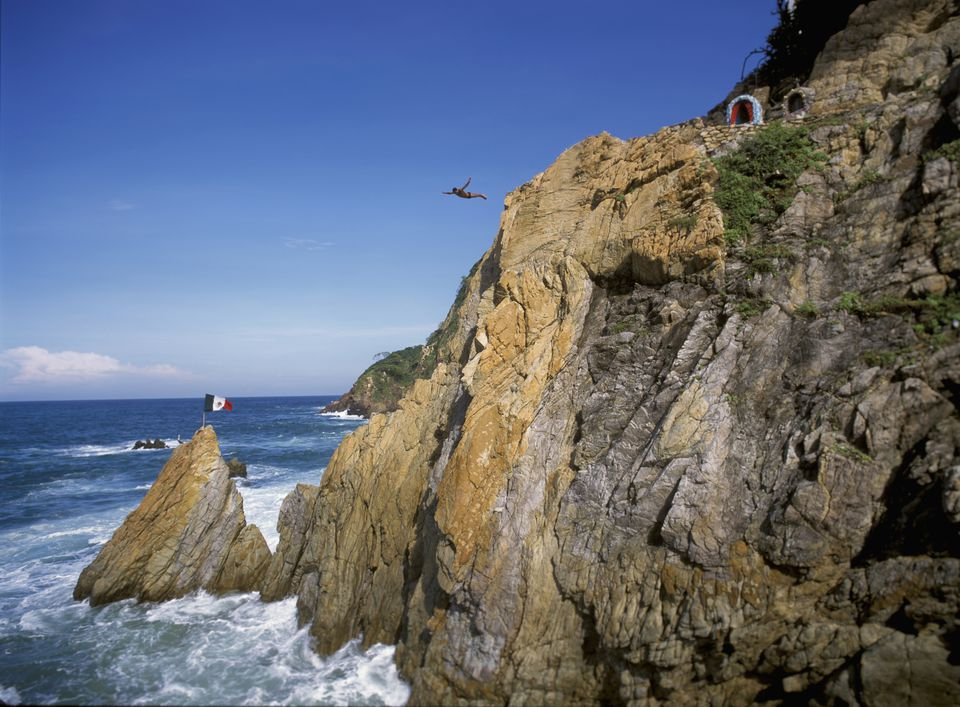 A diver jumps off of La Quebrada cliff in Acapulco, Mexico.