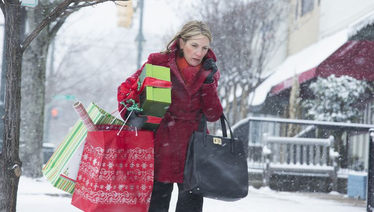 Woman overloaded with holiday shopping bags