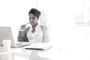 Businesswoman using laptop in office