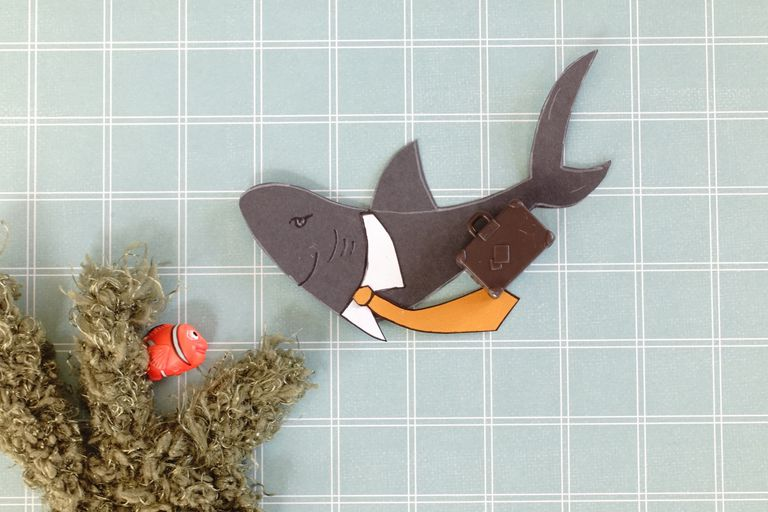 illustration of a shark with a briefcase and wearing a tie