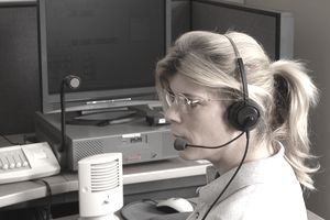 Police dispatcher job duties and salary outlook police dispatcher sitting at a dispatch console thecheapjerseys Image collections
