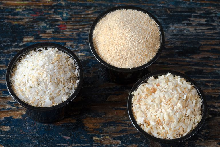 High Angle View Of Minced Onion With Garlic Salt And Powder In Bowls On Wooden Table