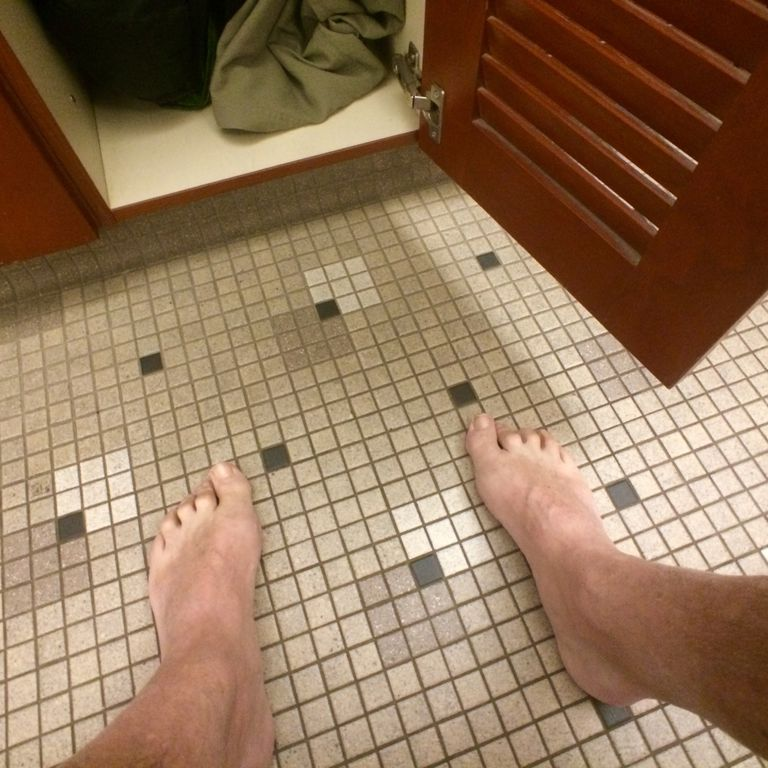 man's feet in locker room