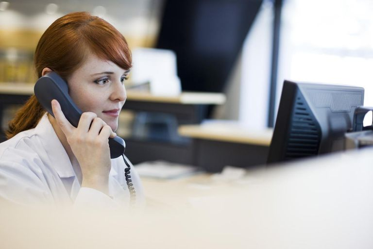 Female receptionist talking on phone