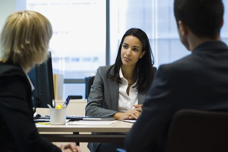 Female executive talking to business partners