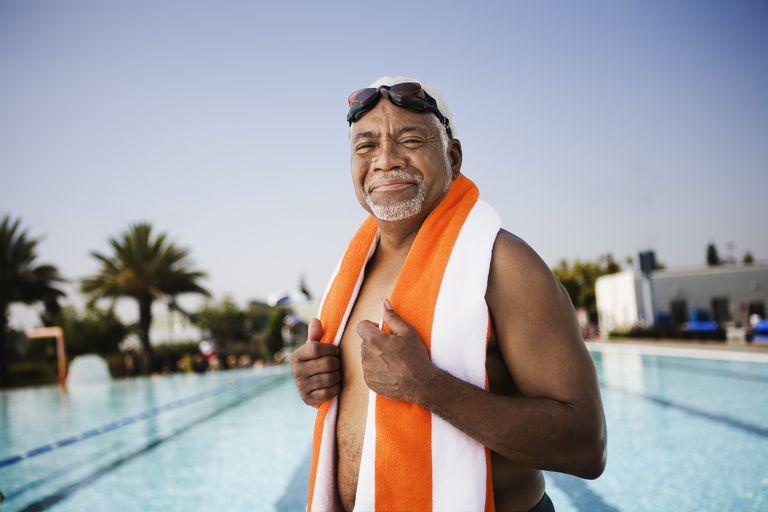 Senior man swimmer with towel