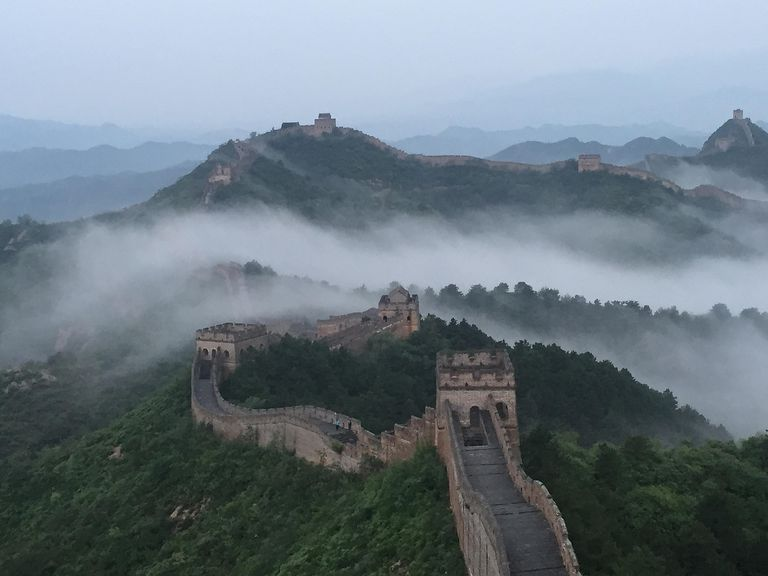 Jinshanling section of the Great Wall of China in the rural mist of Chengde, Hebei Province of China