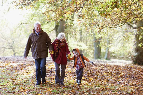 Grandparents walking with grandchild
