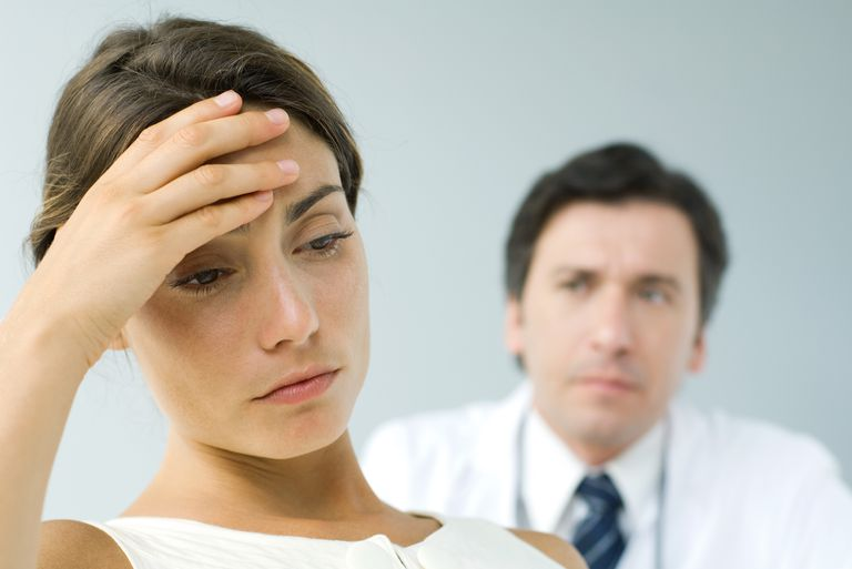 stressed woman and doctor