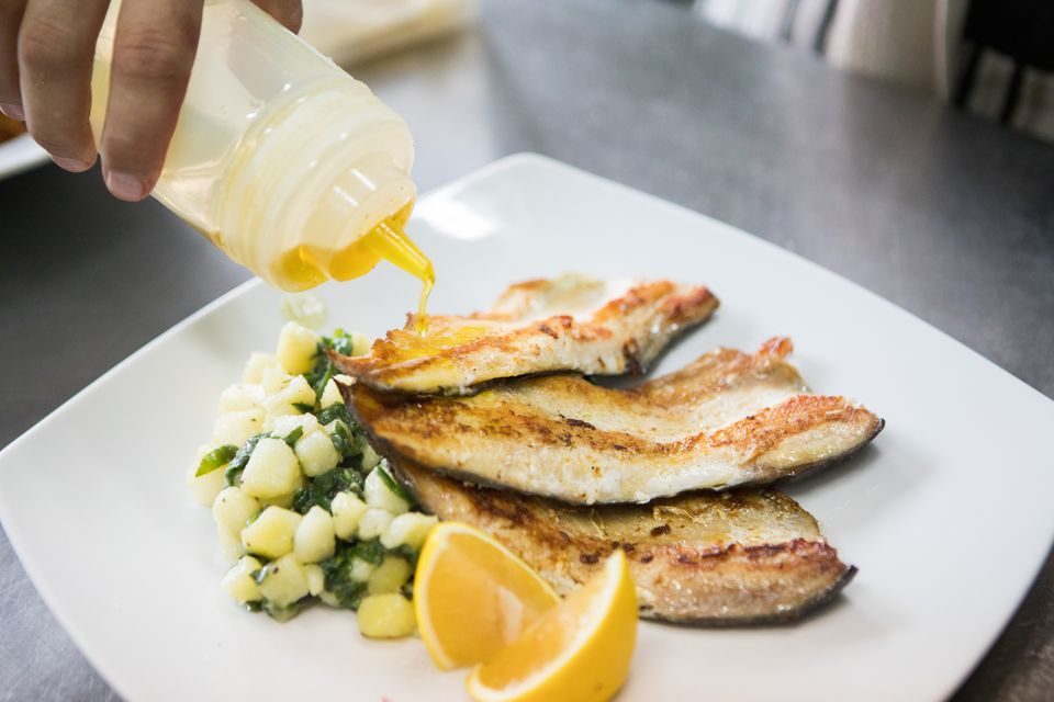 Served roasted trout with side dish