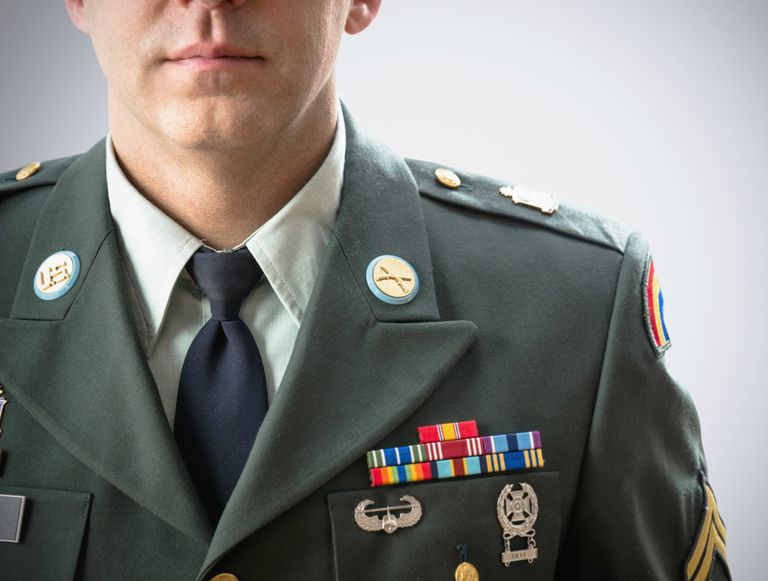 Close up of Caucasian soldier wearing decorated military uniform