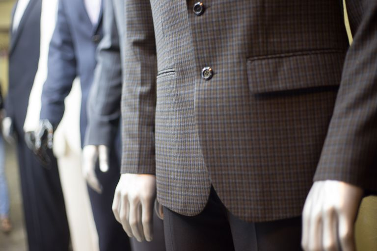 Close-Up Of Suits On Mannequins At Clothing Store