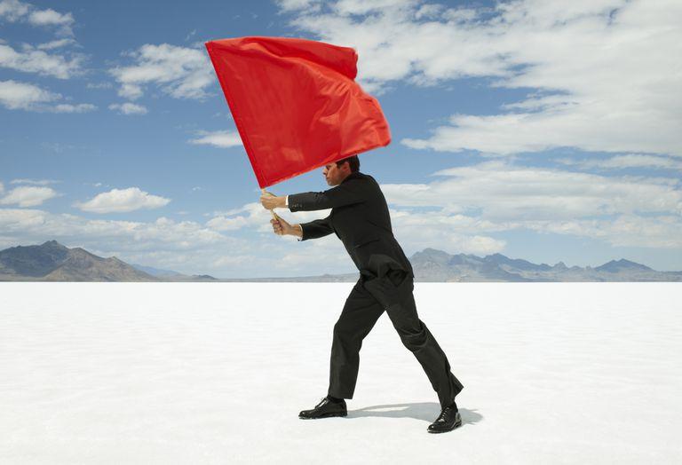 man waving red flag