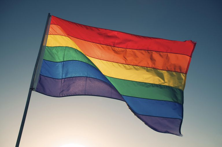 Rainbow Flag Waves Backlit by Bright Sun