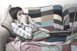 woman home sick with computer