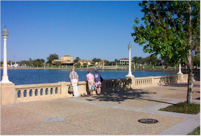People taking in scenic views at Lake Mirror in Lakeland, Florida