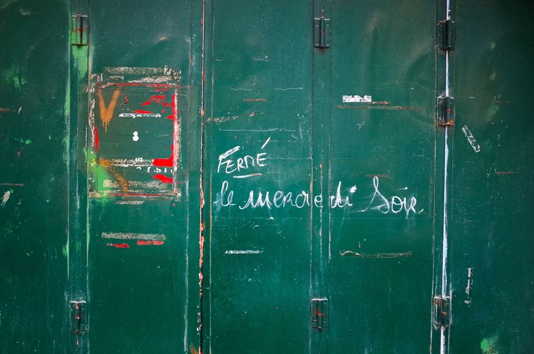 Text Written With Chalk On Green Metallic Wall
