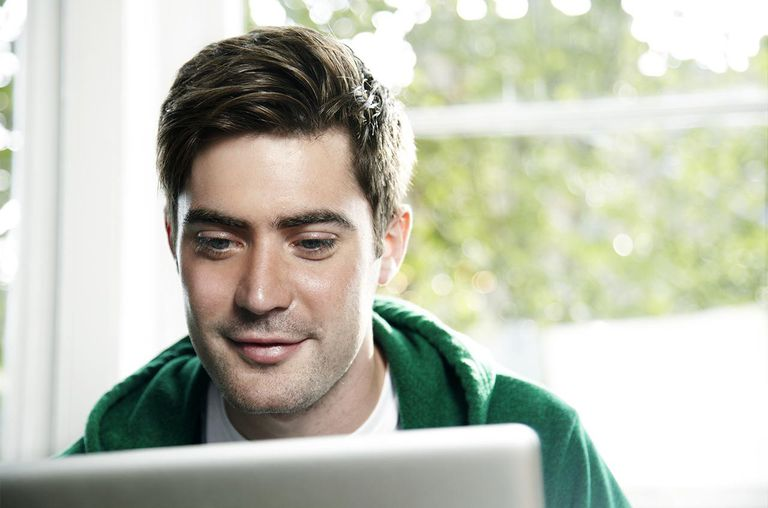 Man working on a laptop from home.