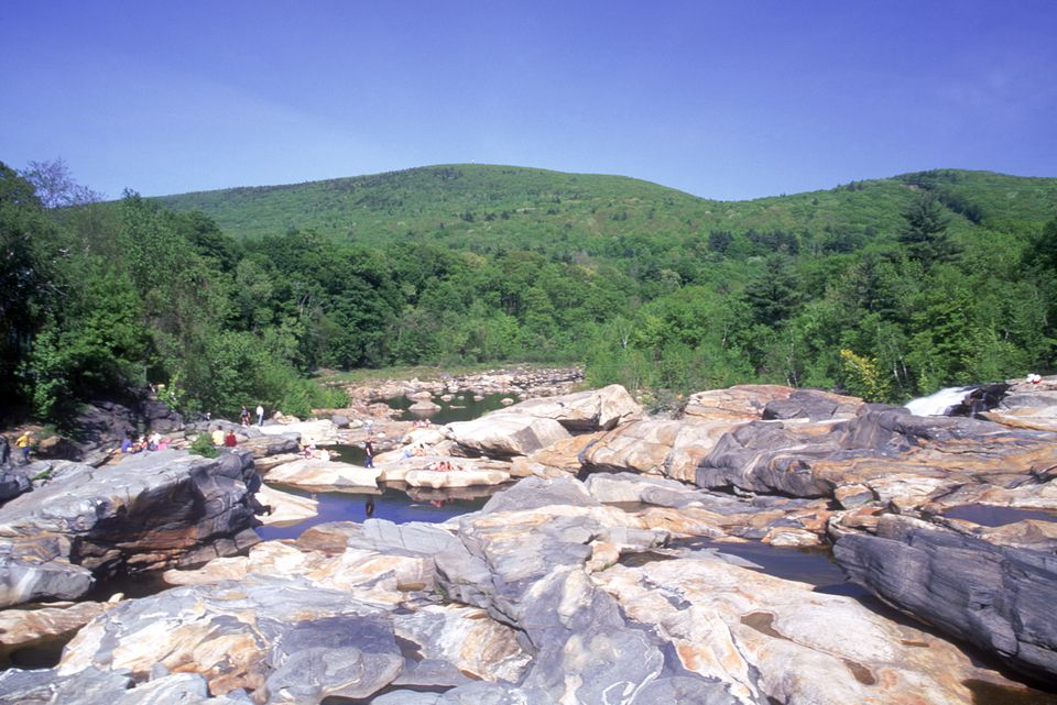 People walking, sunning and reading on glacial potholes, Shelburne Falls, Franklin County, MA