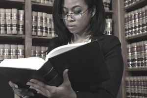 a young woman reading a law book
