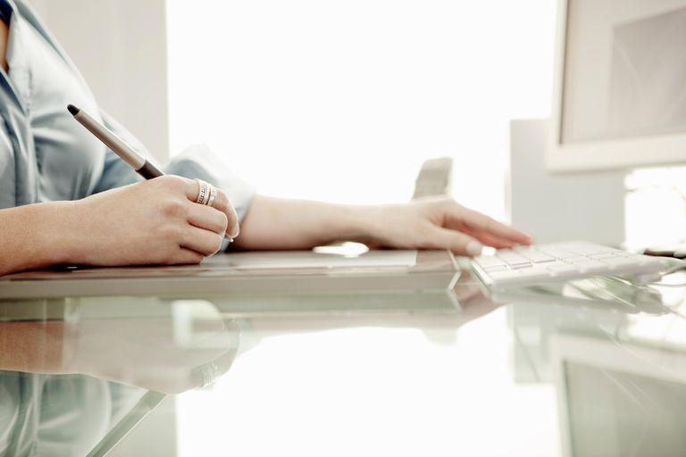 Graphic designer, close-up of hands