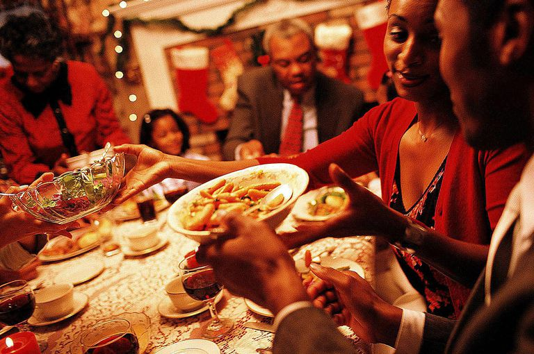 A family shares Christmas dinner together, which for many is an important Christmas ritual that reaffirms social ties.