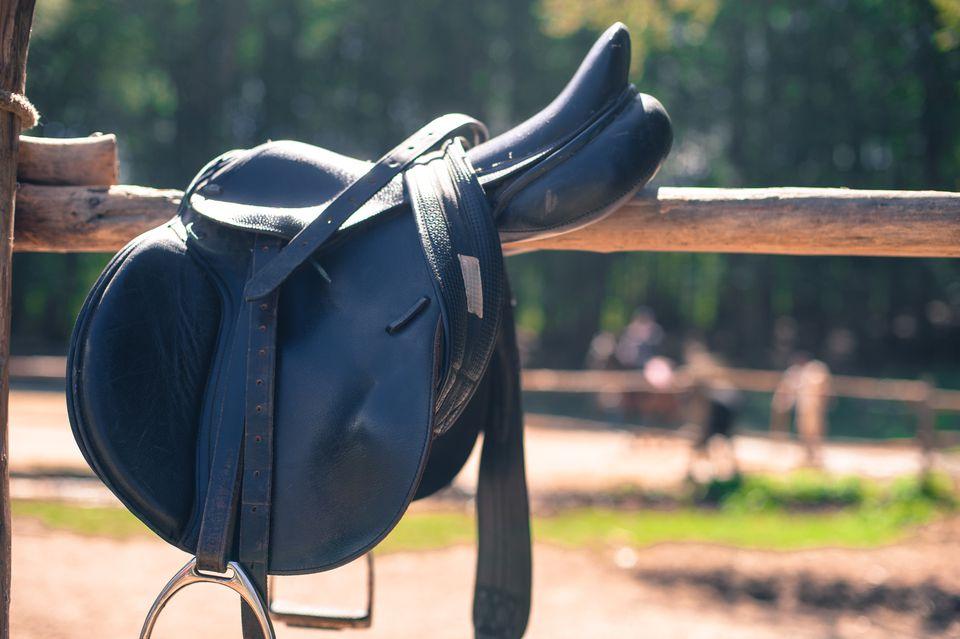 Saddle On Wooden Railing