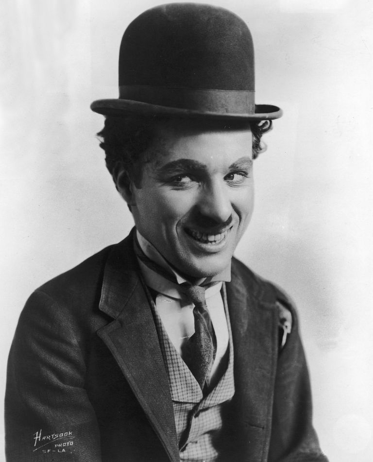 Picture of British comic actor and film director Charles Chaplin in character as the Little Tramp.