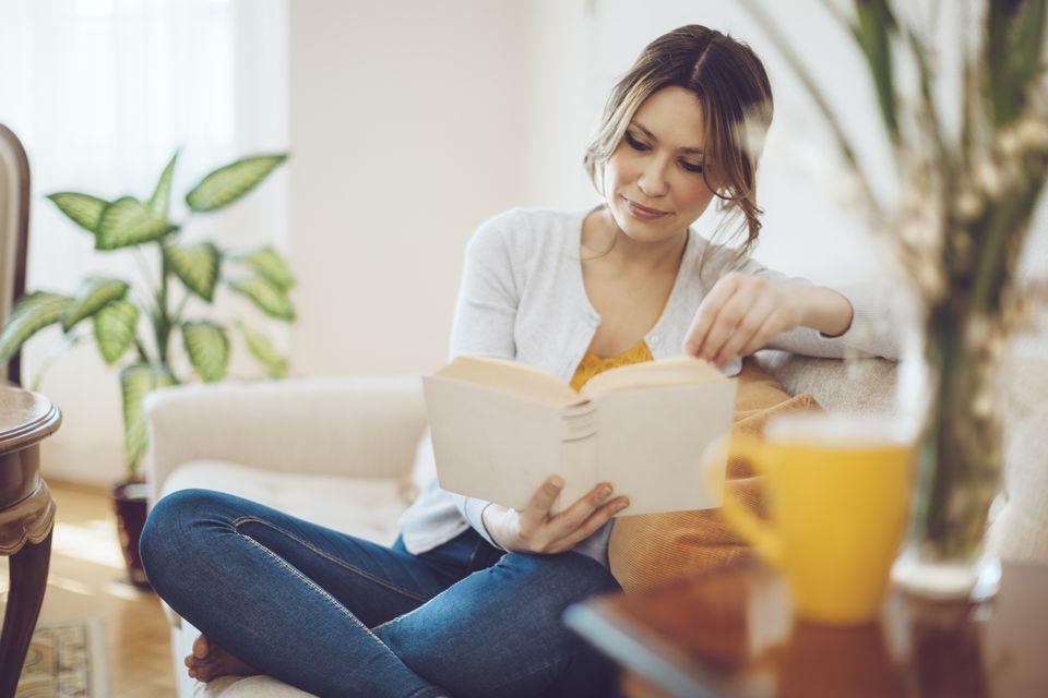 Woman reading feng shui book